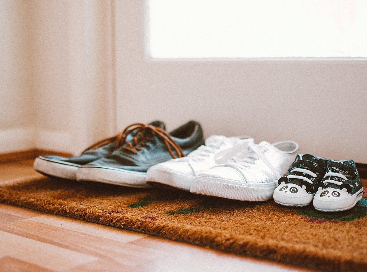 Parents and child's shoes depicting unity and togetherness after receiving family counseling