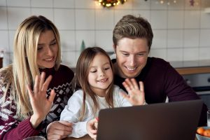 Family smiling and looking at a computer. This family is begining online counseling for anxiety for kids with a skilled online anxiety therapist, Helena, Madsen. If you're seeing your child struggle with changes. Therapy in Illinois can help with Briefly Counseling. Begin today!