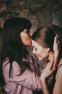 Mother kissing daughters forehead. Teens with anxiety in Illinois and Chicago, IL, are not always straightforward with anxiety symptoms. If anxiety in teens is getting out of hand, work with an anxiety therapist in anxiety counseling for guidance in Libertyville 60048, Crystal Lake 60012 , Lake forest 60035, or Chicago, IL today.