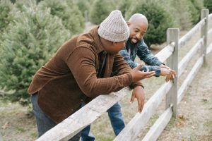 Picture of black men outside with leaning on fence. Teens with anxiety in Chicago, IL need to overcome anxiety symptoms individually, with your support. If they need more help, online anxiety counseling for teens in Illinois, Chicago, or Champaign may help.