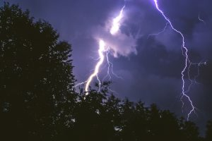 Thunderstorm and bright lightening bolt at night. Child can have many fears such as loud thunderstorms. Getting them in online anxiety therapy may help. Here they can talk with an anxiety therapist who can help them overcome fears. Try counseling for anxious kids in Illinois, Champaign, Chicago, or anywhere in Illinois.