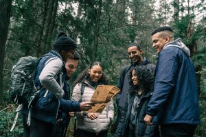 Group of teens outside in forrest smiling. Dealing with anxiety is common. We've all lost time and connections. Give your teens support if you're noticing dealing with anxiety is overtaking their life. Begin anxiety treatment and get support for anxiety in kids in Chicago, IL today!